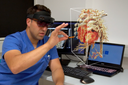 Pediatric cardiologist Muhannad Alkassar explores a 3D image of the heart with a hologram