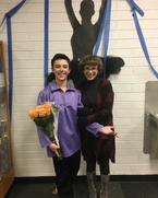 Anne and Zane with flowers in his hand behind the scenes of one of his shows.
