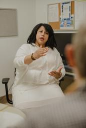Lisa B. Jones sits in an office and talks about the time she had breast cancer.