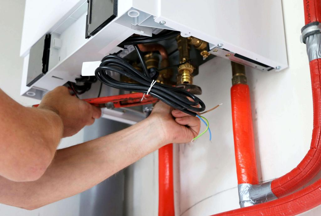A Viessmann boiler being installed.