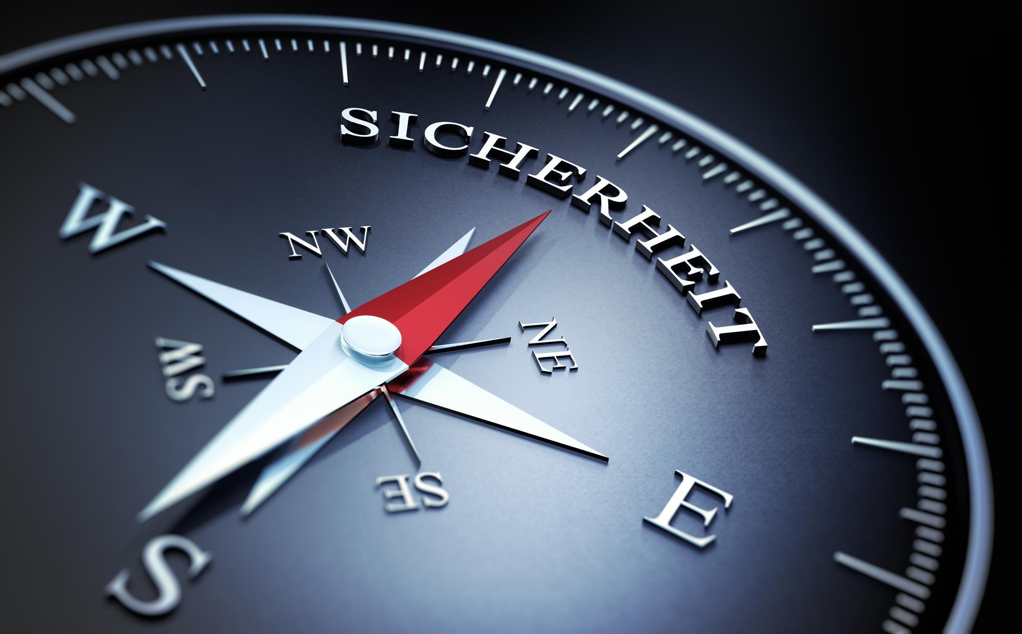 Kompass, dessen Nadel auf das Wort Sicherheit zeigt