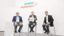 Scientists and physicians at Siemens Healthineers show their enthusiasm for Biograph Vision Quadra by holding up a smiling face