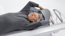 Man laying on Symbia Intevo Bold scanner bed