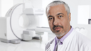 Doctor standing in front of Symbia Intevo SPECT/CT scanner