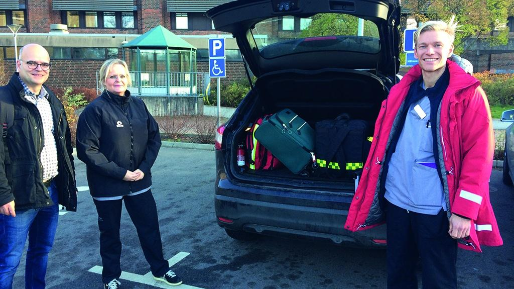 The mobile care team loading the equipment for a visit to a patient.