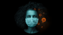 Woman with mask with COVID-10 virus around