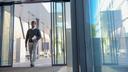 A man walking through open sliding glass doors