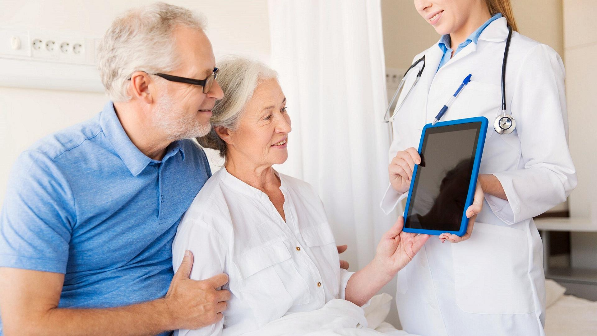 doctor shows patient something on a tablet