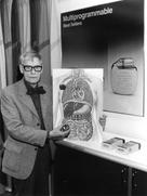 Rune Elmqvist shows a replica of the first fully implantable pacemaker, 1983