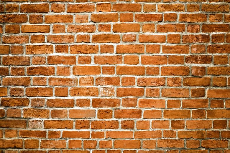Mauerwerk-Wand im Innenbereich als Hintergrund für Wandfliesen