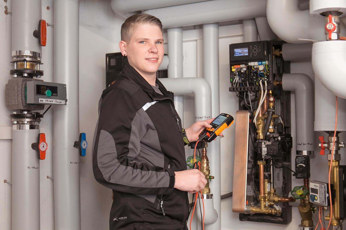 The image shows field service technician Patrick Schardt at a heating system.