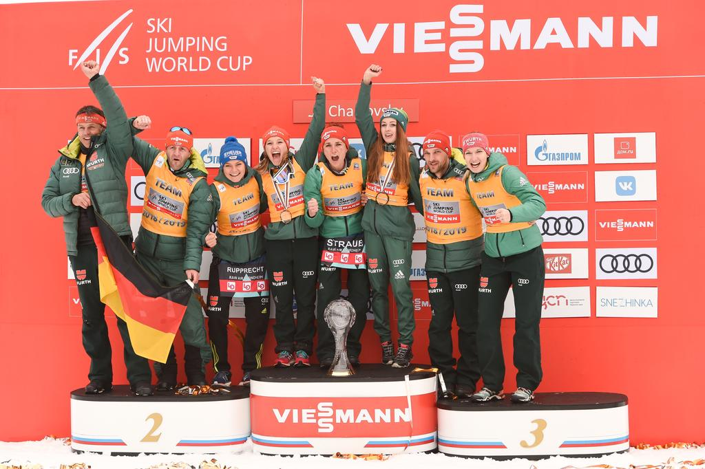 The image shows the ladies' team in ski jumping.