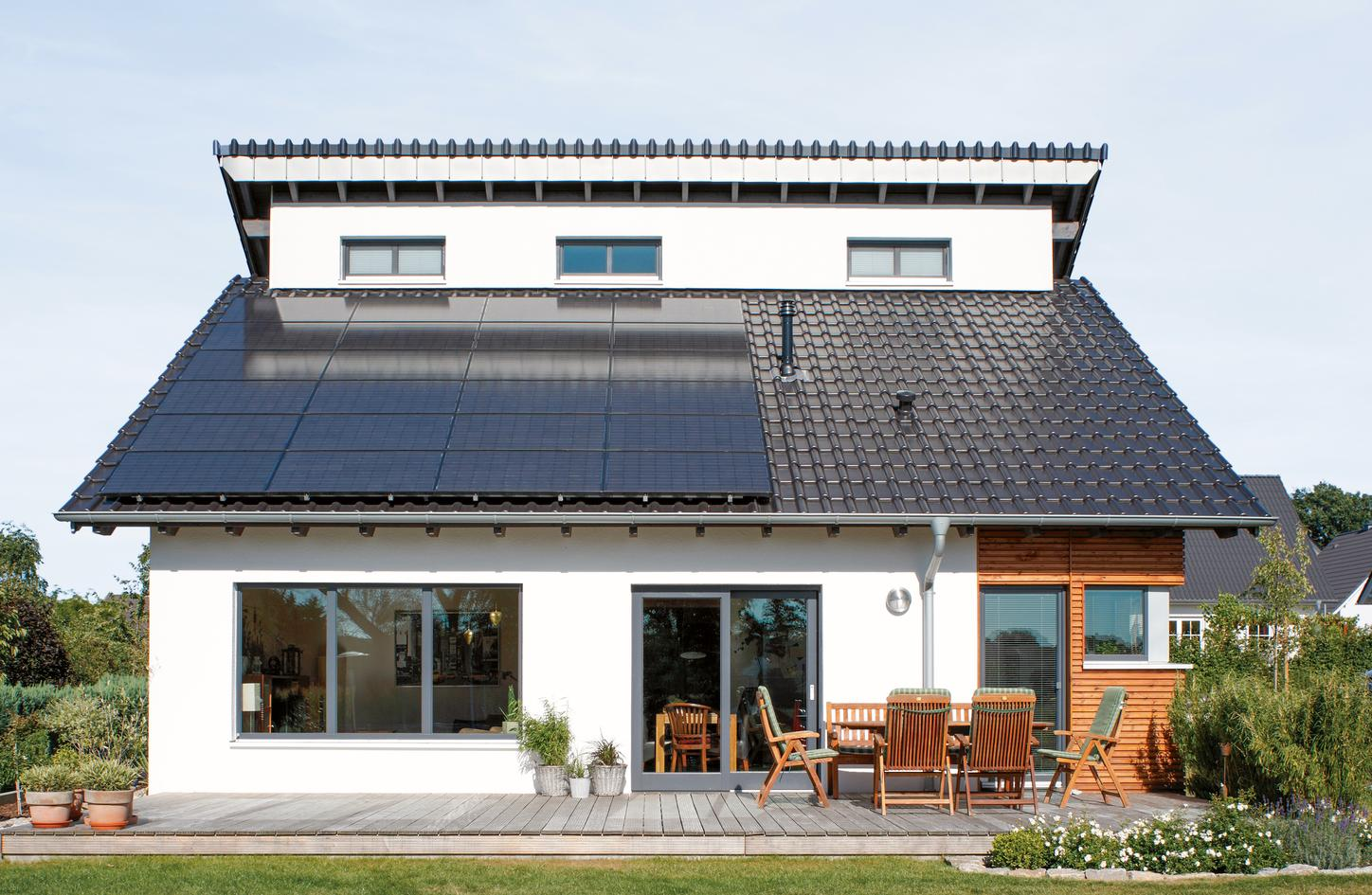 The image shows a house with photovoltaics.
