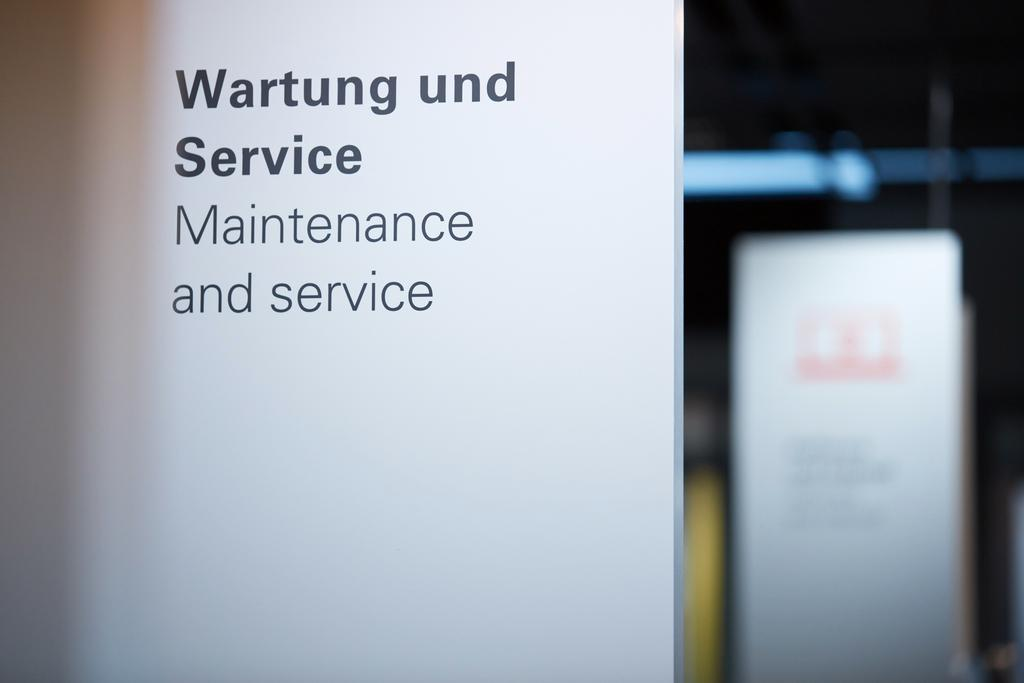 The image shows a sign indicating maintenance and service.