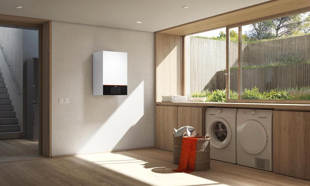 Das Bild zeigt eine Waschküche mit einer Viessmann Vitodens aus der 300er Serie.