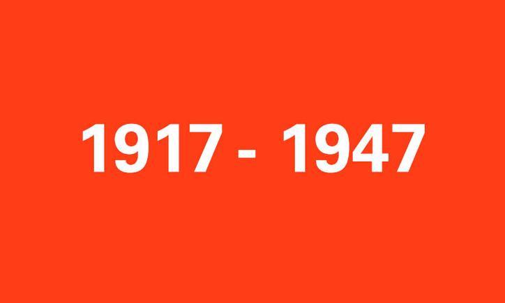 Das Bild zeigt eine rote Kachel mit der Aufschrift 1917-1974