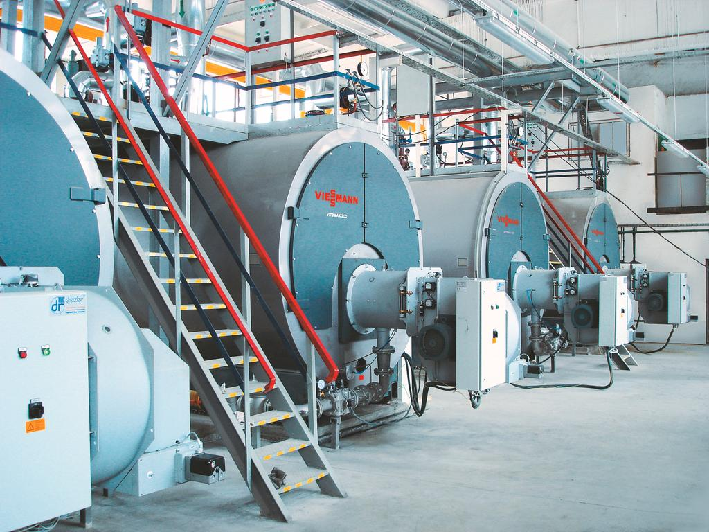 The picture shows large industrial boilers from the Vitomax product range
