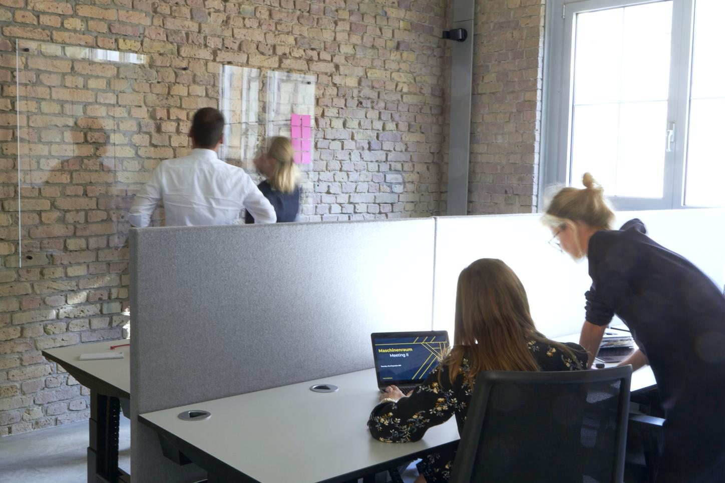 The image shows discussing people in a room.