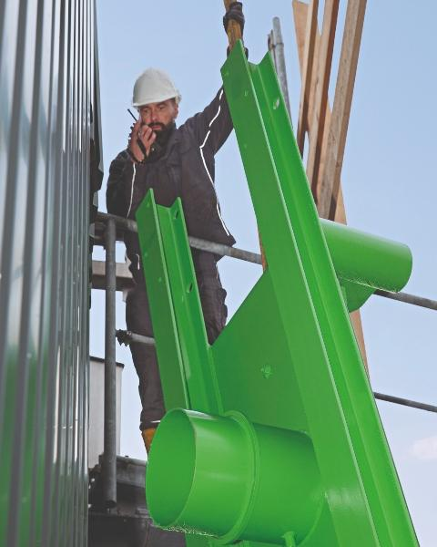 The picture shows a worker at crane work