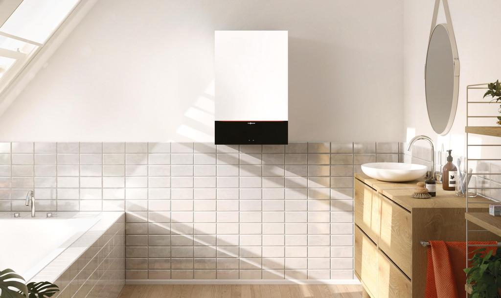 The photo shows the wall mounted Vitodens 200-W in a bathroom.