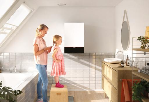 The picture shows a mother and her daughter in a bathroom with Viessmann wall mounted appliance