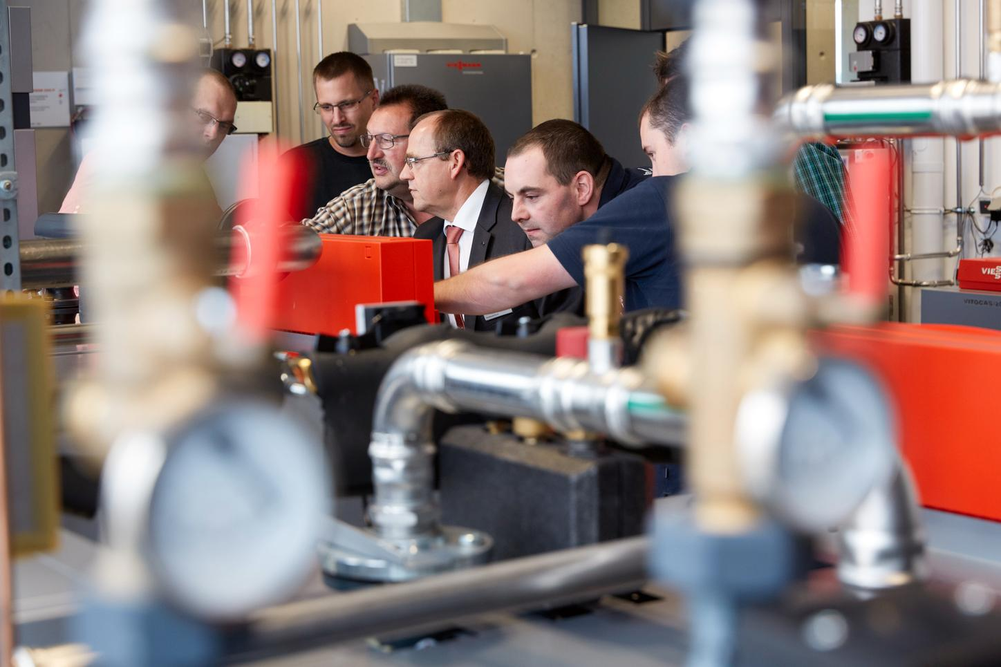 The picture shows employees during a product training.