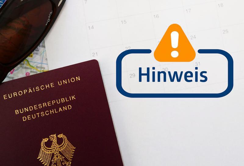 Reisepass mit Hinweissschild
