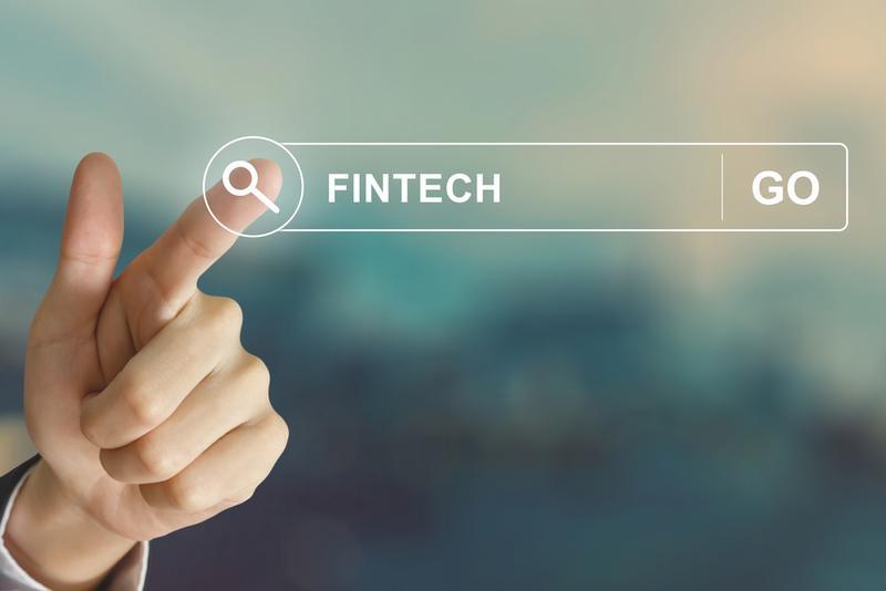 business hand clicking fintech or financial technology button on