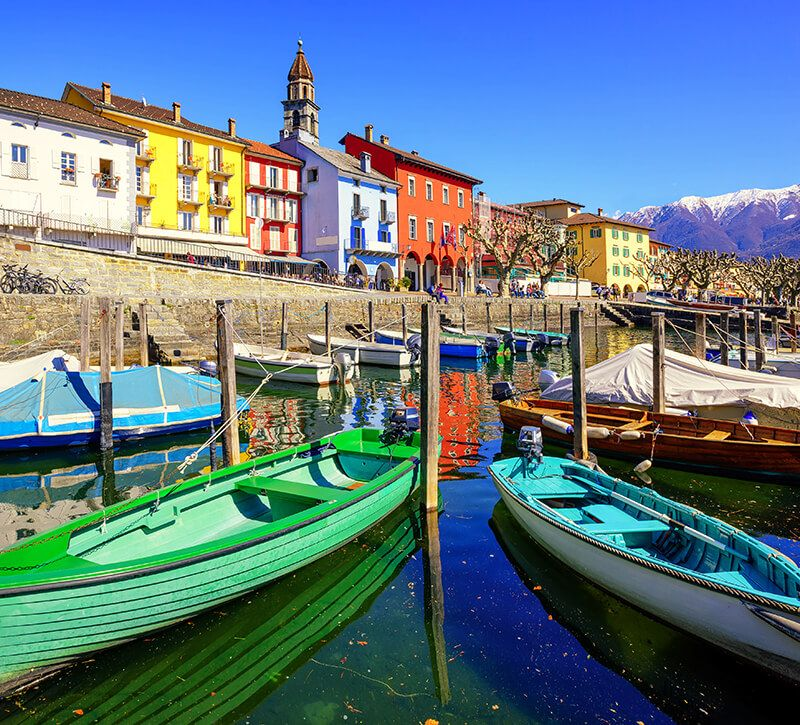 Schweiz Tessin Ascona Hafen berge und meer