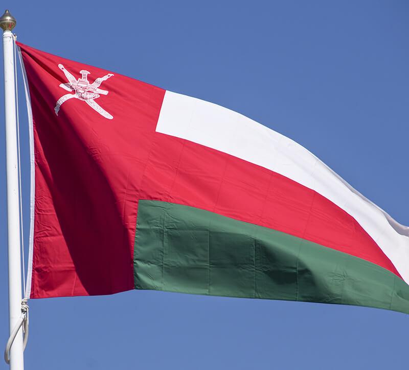 Oman Flagge berge und meer
