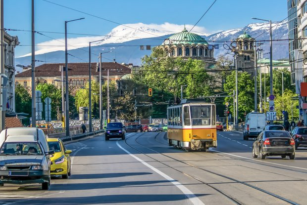 Sofia bulgaria the church sveta nedelya cathedral of the sofia bishopric traffic boulevard knyaginya mariya luiza in the background the vitosha mountain sofia bulgaria