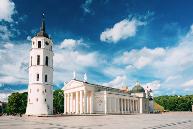 Vilnius lithuania view of bell tower and facade of cathedral basilica of st stanislaus and st vladislav on cathedral square famous landmark showplace in sunny summer under blue sky with clouds original