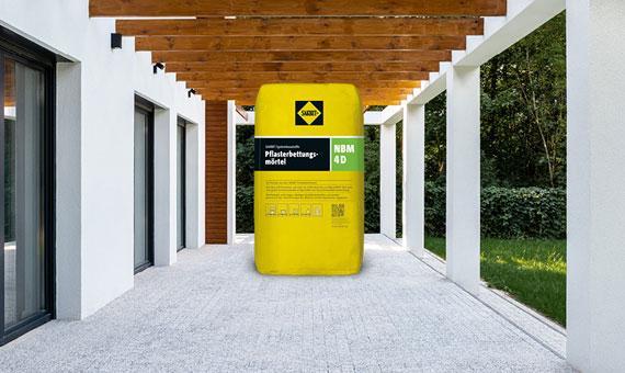 Produkt des Monats Pflasterbettungsmörtel NBM 4D Gebinde auf Terrasse