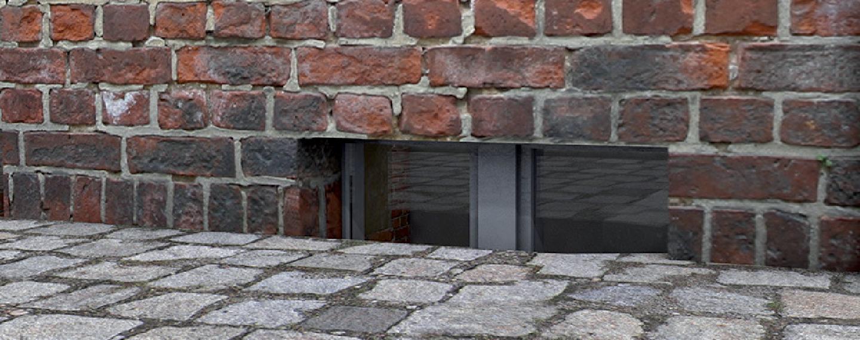 Fassadensanierung | Ausgewaschen Fugen und verwitterter Mörtel am Mauerwerk