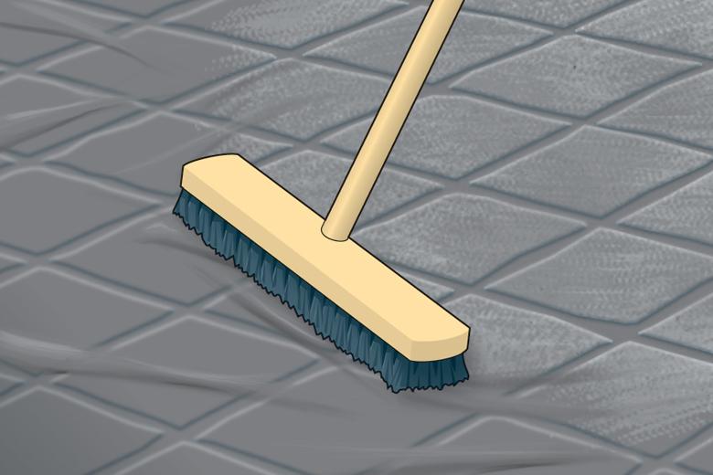 Fläche mit einem Besen reinigen