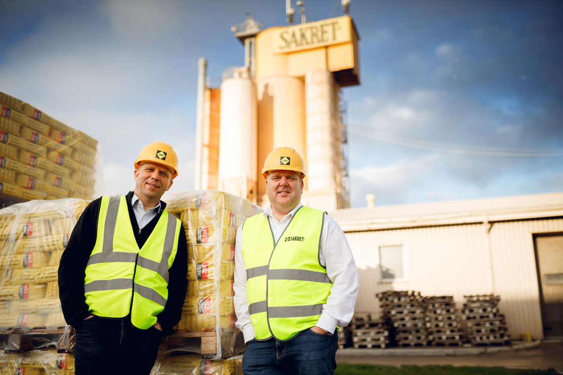 Thumbnail Dr. Andris Vanags and Juris Grinvalds in front of Silo and bags