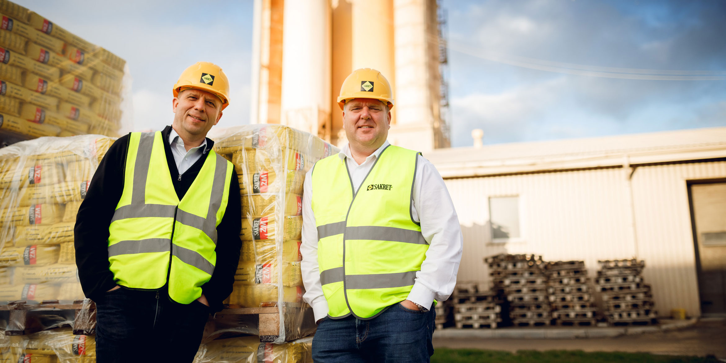 Dr. Andris Vanags and Juris Grinvalds in front of Silo and bags, large