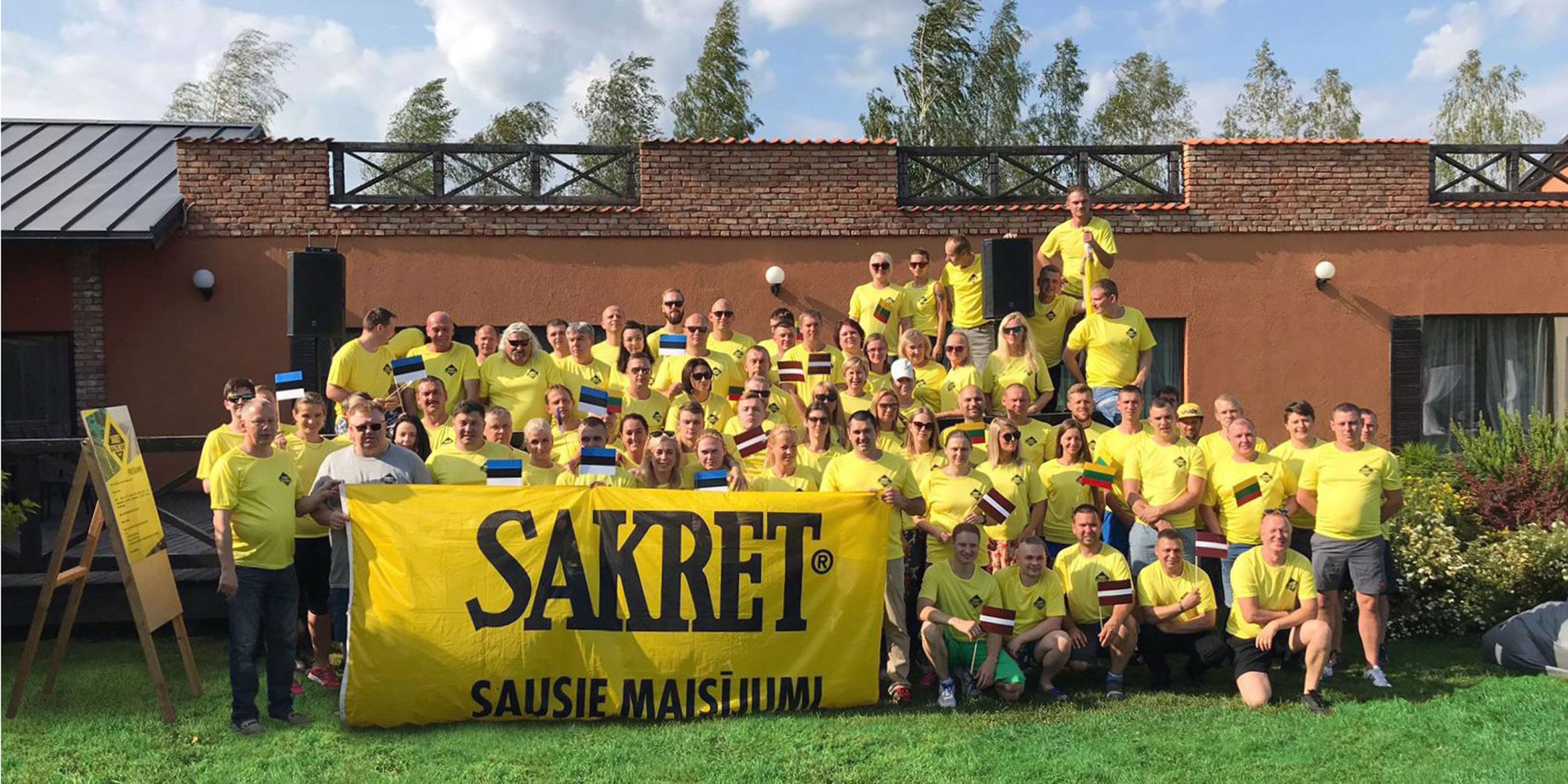 SAKRET employees group shot with SAKRET banner