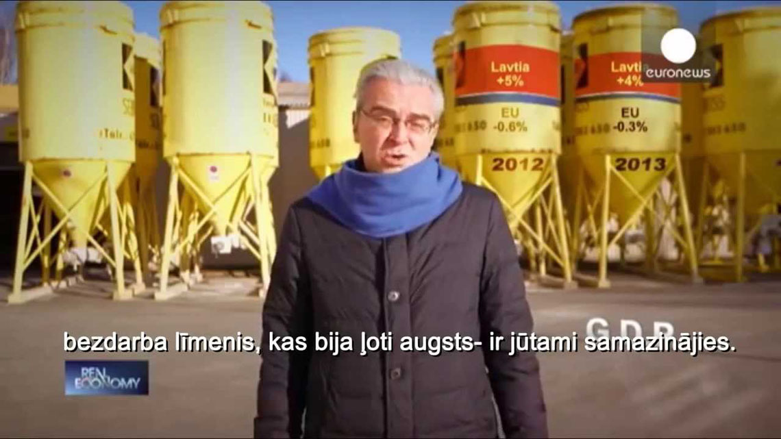 Euronews journalist standing in front of SAKRET SIA silos