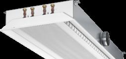 Besonders flacher, zweiseitig ausströmender Deckeninduktionsdurchlass für 600er und 625er Deckenraster mit horizontalem Wärmeübertrager